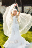 Blonde bride in lace dress backgroung wall in garden. Gently blonde bride in lace dress backgroung wall in garden Royalty Free Stock Photography