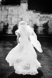 Blonde bride in lace dress backgroung wall in garden Stock Photography