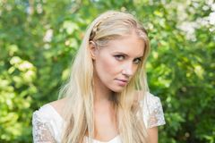 Blonde bride looking peacefully at camera Royalty Free Stock Photo
