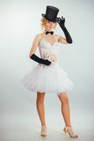 Blonde bride in tophat with veil and long black gloves Stock Photos