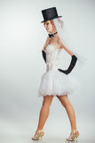 Blonde bride in tophat with veil and long black gloves Royalty Free Stock Photos