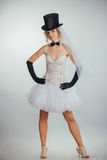 Blonde bride in tophat with veil and long black gloves Stock Images