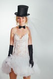 Blonde bride in tophat with veil and long black gloves Royalty Free Stock Image