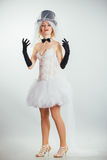 Blonde bride in tophat with veil and long black gloves Stock Photo