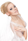 Blonde bride with a veil. Royalty Free Stock Photography