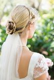 Blonde bride in a veil Stock Photography
