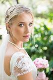 Blonde bride in a veil looking to camera Royalty Free Stock Photography