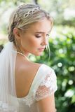 Blonde bride in a veil rear view Stock Images