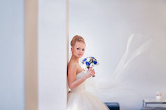 Blonde bride with a veil on white interior with copy space Stock Photography