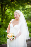 Blonde bride with a wedding bouquet Royalty Free Stock Photo