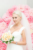 Blonde bride in white dress Royalty Free Stock Photo