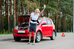 Blonde and broken car Stock Images