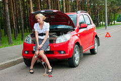 Blonde and broken car Stock Image