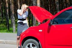 Blonde and broken car Stock Photos