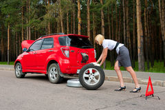 Blonde and broken car Royalty Free Stock Photography