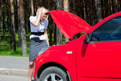 Blonde and broken car Stock Image