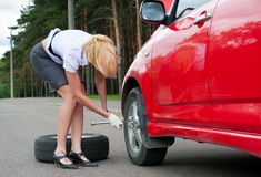 Blonde and broken car Royalty Free Stock Images