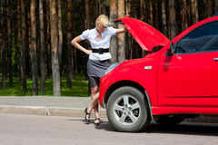 Blonde and broken car Stock Photography