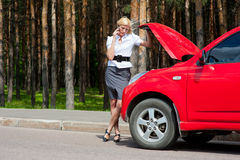 Blonde and broken car Royalty Free Stock Photo