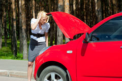 Blonde and broken car Stock Photo