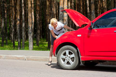 Blonde and broken car Royalty Free Stock Image