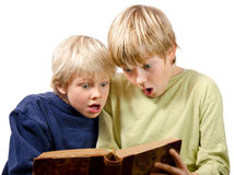 Blonde brothers reading Stock Photos