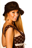 Blonde in brown dress and hat Stock Image