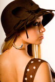 Blonde in brown dress and hat Stock Photography