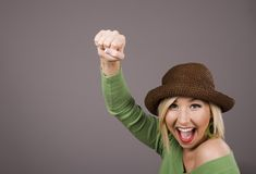 Blonde in Brown Hat Fist in Air Stock Photo