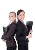 Blonde and brunette business woman with file folders Royalty Free Stock Images