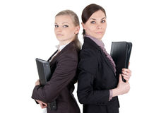 Blonde and brunette business woman with file folders Royalty Free Stock Image
