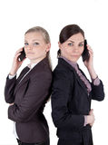 Blonde and brunette business woman with phone Stock Photo