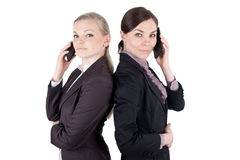 Blonde and brunette business woman with phone Royalty Free Stock Photography