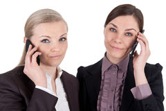Blonde and brunette business woman with phone Royalty Free Stock Photo