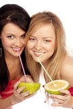 Blonde and the brunette drink juice of citrus Stock Photography