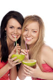 Blonde and the brunette drink juice of citrus Royalty Free Stock Photos