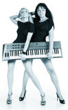 Blonde and brunette with electric piano Stock Photos