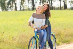 Blonde and brunette girls during cycling Stock Photos