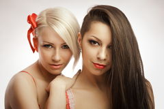 Blonde and brunette portrait Stock Image