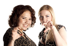 Blonde and the brunette in a role of leopards Royalty Free Stock Image