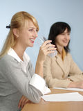 Blonde and brunette women Stock Image