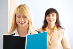 Blonde and brunette women in office Stock Photo