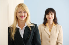 Blonde and brunette women in office Royalty Free Stock Photo