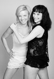 Blonde and brunette women in slips Royalty Free Stock Photography