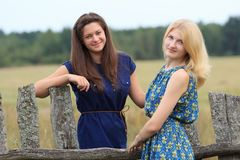 Blonde and brunette young women in dresses Royalty Free Stock Photo
