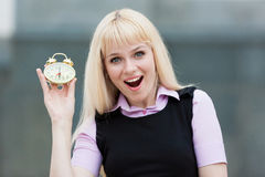 Blonde business  woman  alarm clock Royalty Free Stock Images