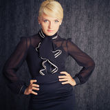 Blonde business woman in black suit Royalty Free Stock Photo