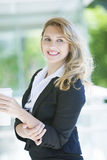 Blonde business woman. Happy young blonde business woman Royalty Free Stock Photo