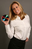 Blonde business woman holding CD. Blonde business woman smiling and holding CD Stock Images