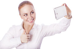Blonde business woman manager worker smiles showing thumb up and Royalty Free Stock Image